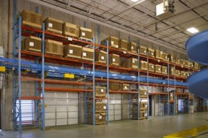 Industrial shelving system using slotted angle racks